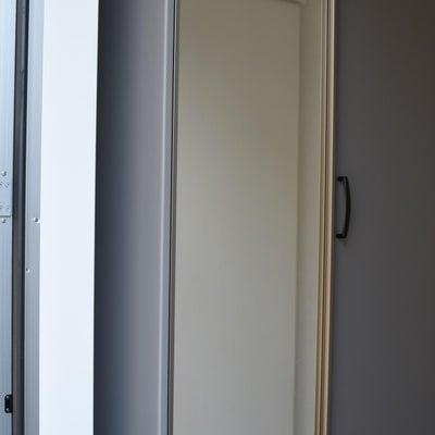 玄関の無駄な空間に置いた無印品の画像